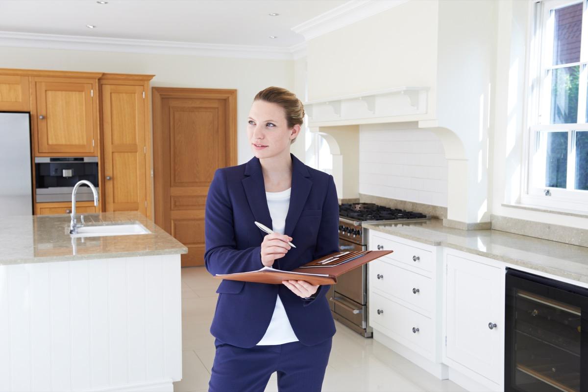 Realtor evaluating a home
