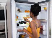 Woman looking in the fridge