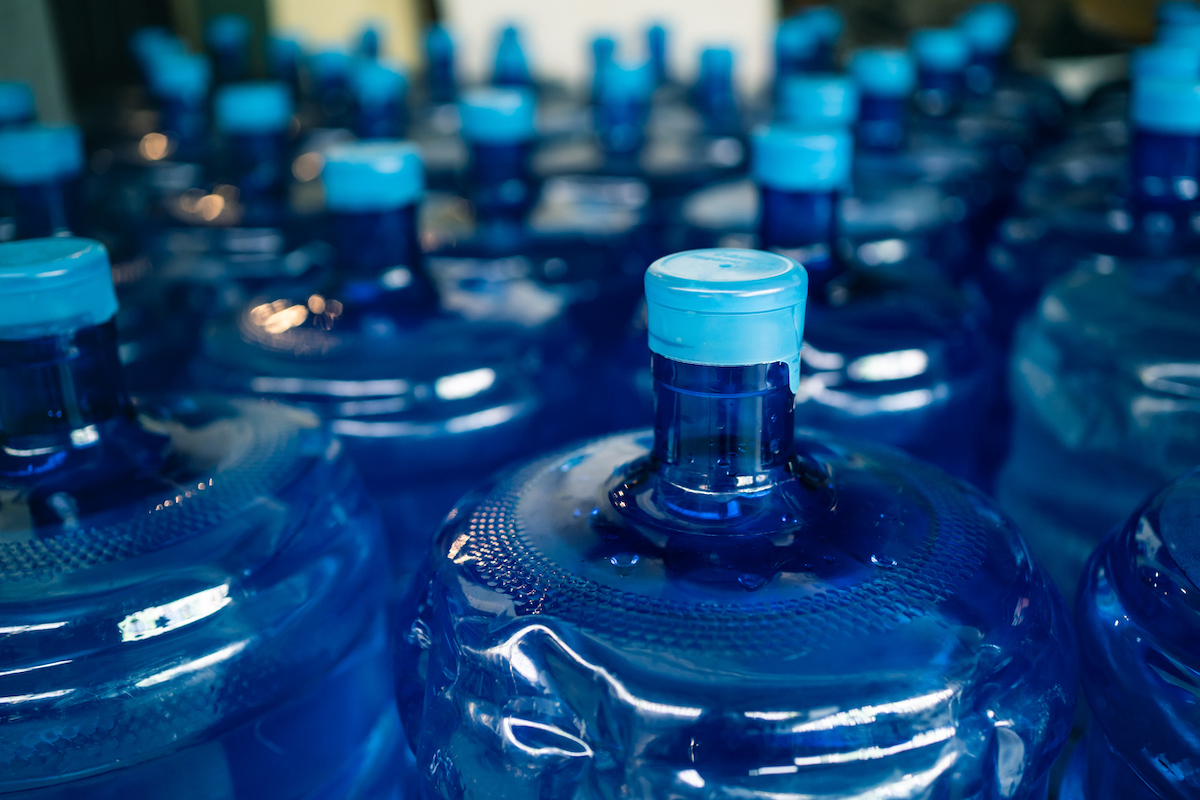 A pile of large drinking water bottles