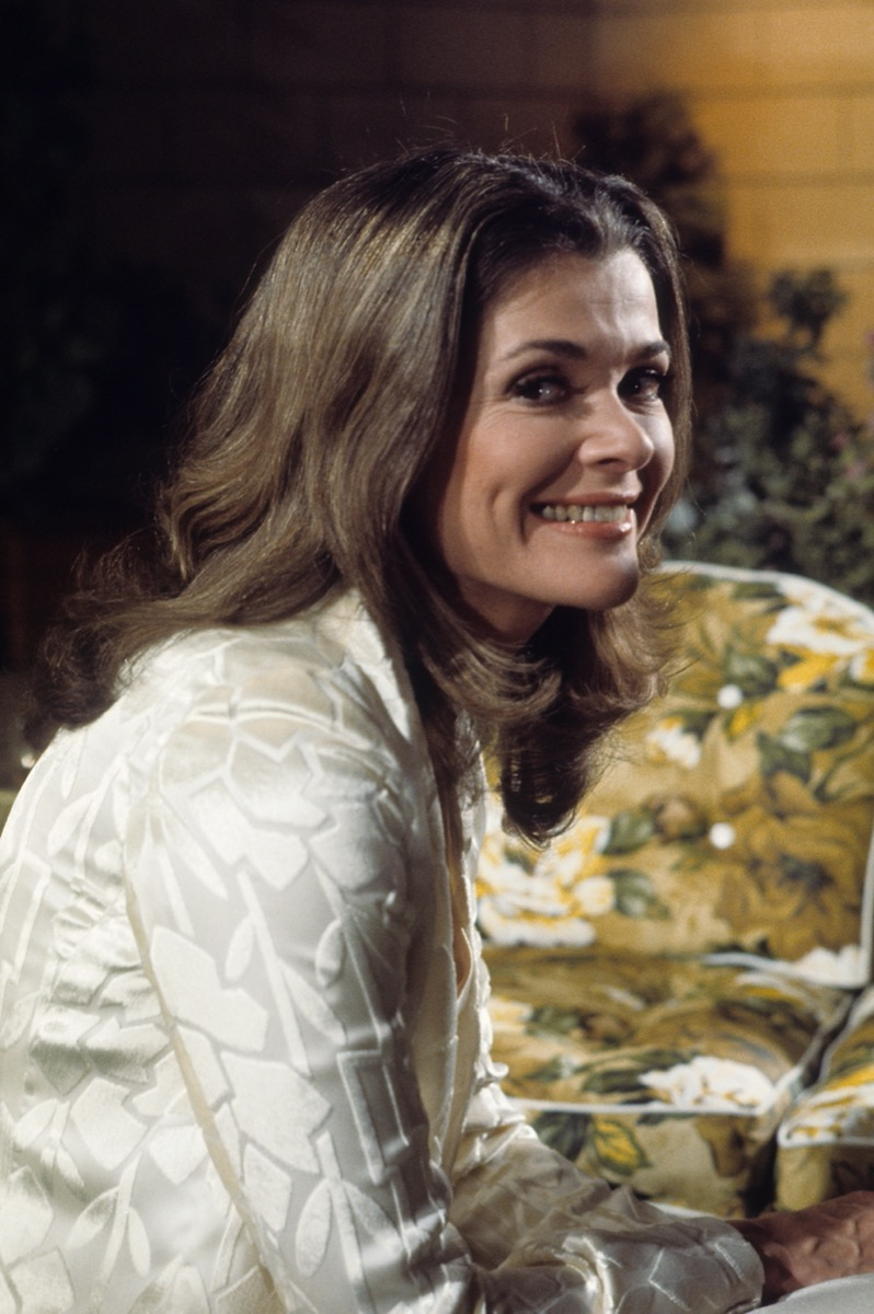 jessica walter in white top smiling at camera