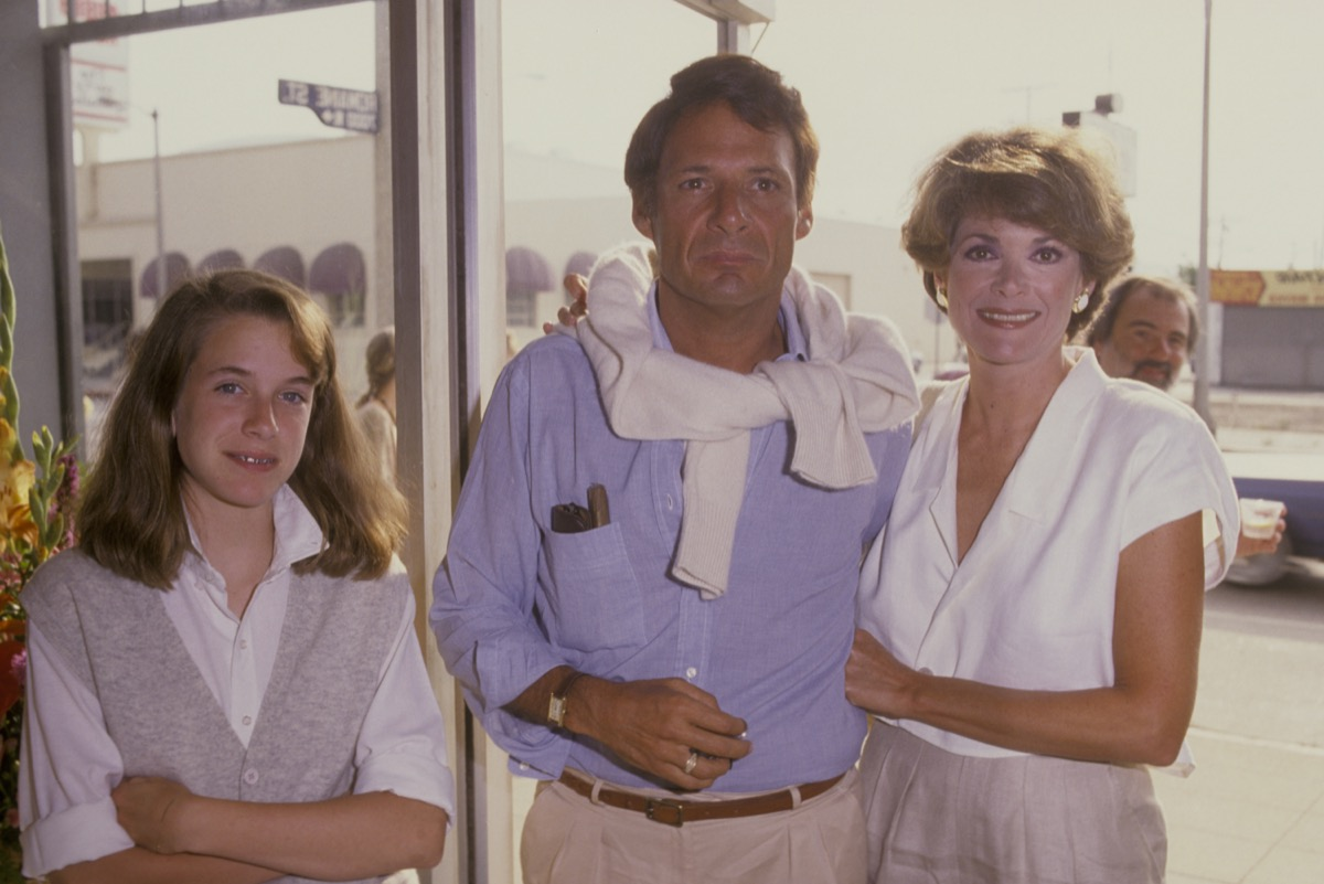jessica walter with her husband and daughter wearing preppy 80s clothing posing outdoors