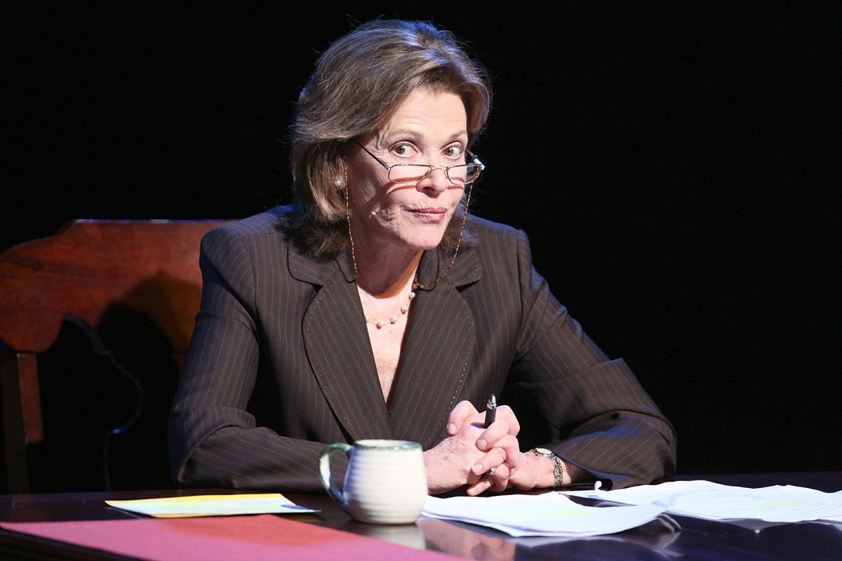 jessica walter wearing glasses sitting at a desk