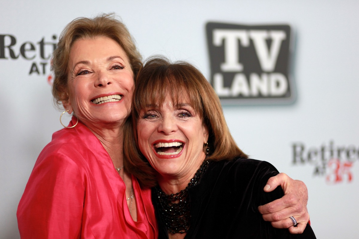 jessica walter in red top hugging valerie harper in black in front of tv land step-and-repeat