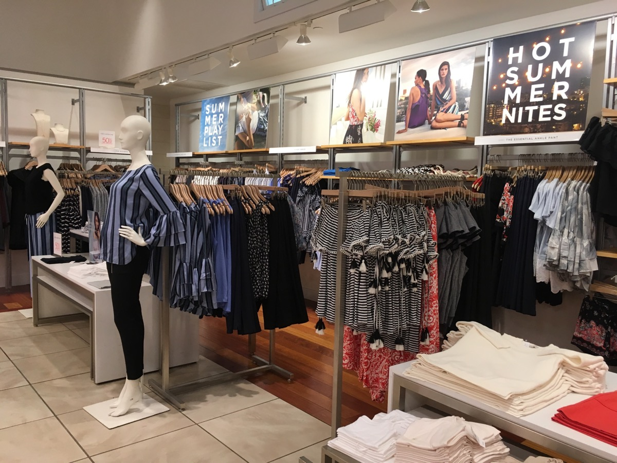 interior of loft clothing store with mannequins and clothes on racks