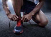 Man tying running shoes