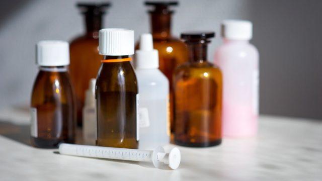 medicine bottles and syringe