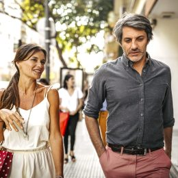 couple walking down the street after shopping in the city