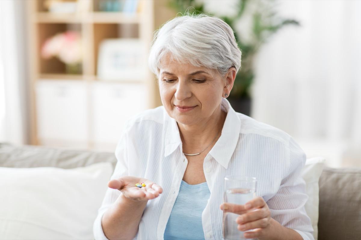 older woman taking pills