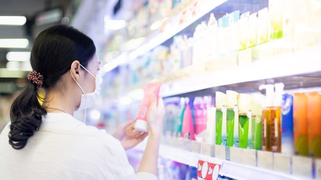 Woman looking at beauty product