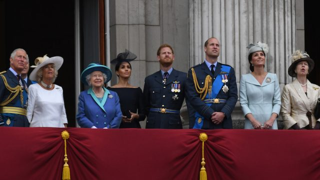 Prince Charles, Prince of Wales, Camilla, Duchess of Cornwall, Queen Elizabeth ll, Meghan, Duchess of Sussex, Prince Harry, Duke of Sussex, Prince William, Duke of Cambridge, Catherine, Duchess of Cambridge and Princess Anne, the Princess Royal stand on the balcony of Buckingham Palace to view a flypast to mark the centenary of the Royal Air Force (RAF) on July 10, 2018 in London, England.