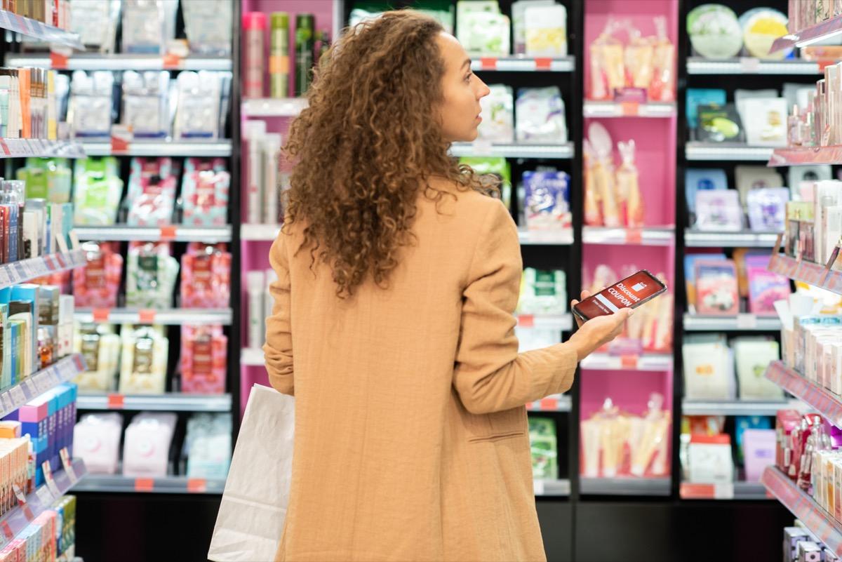 Woman shopping in beauty aisle