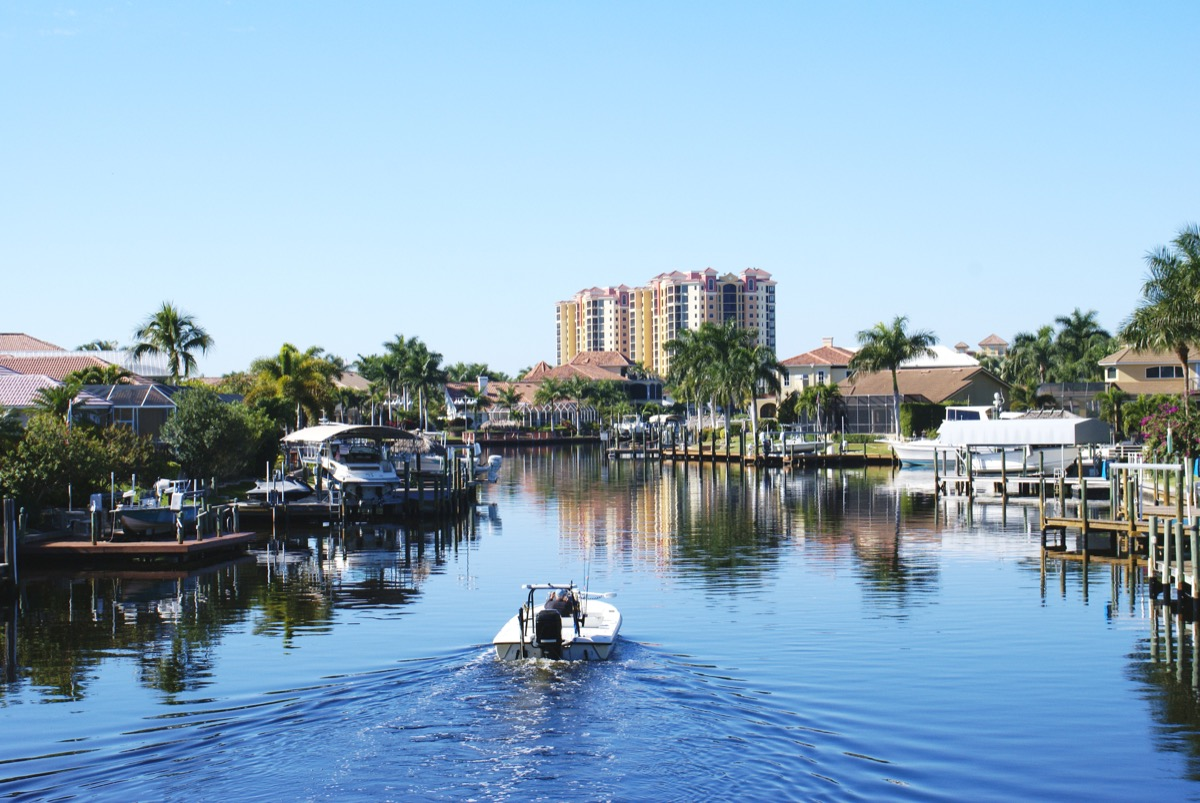 boat in water, cape coral, florida, canal, palm trees