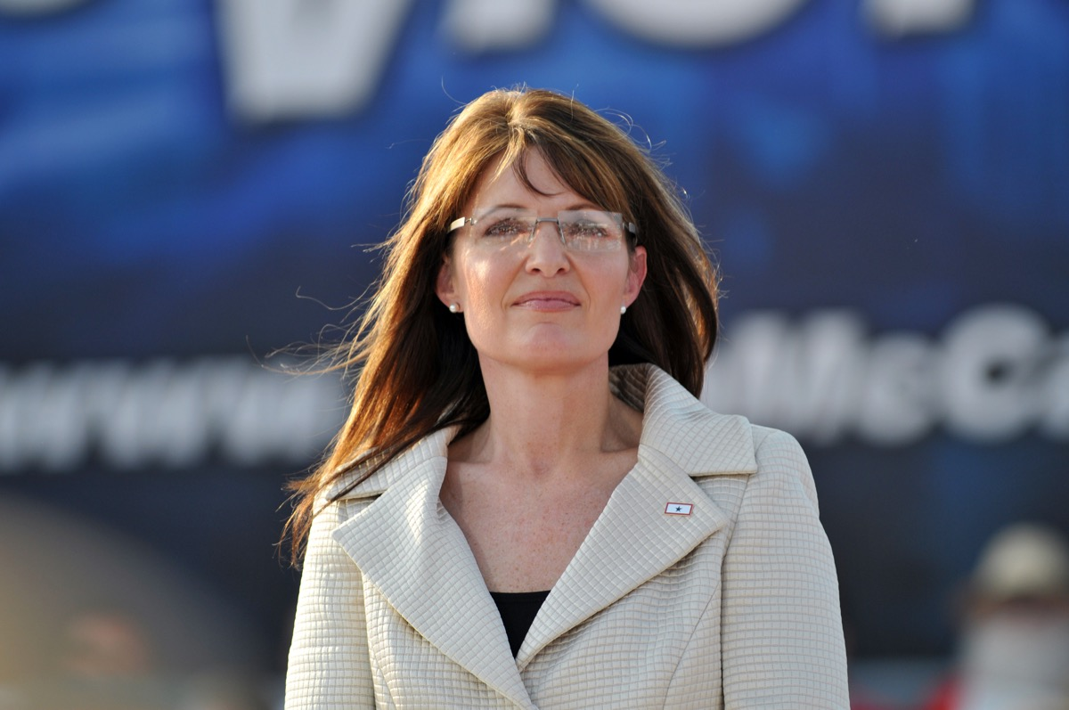 sarah palin wearing a light colored blazer and glasses