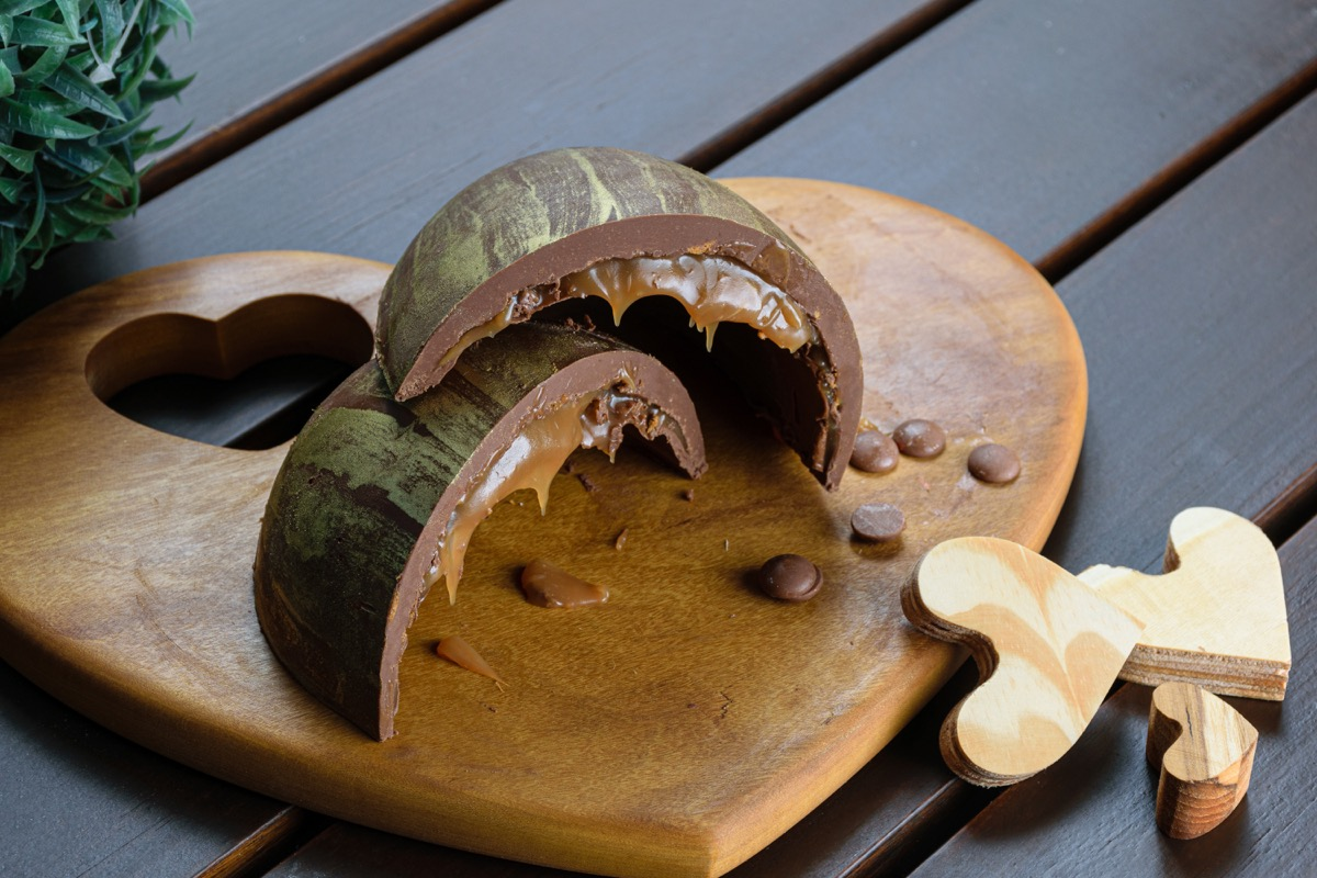 caramel chocolate easter eggs on wooden board