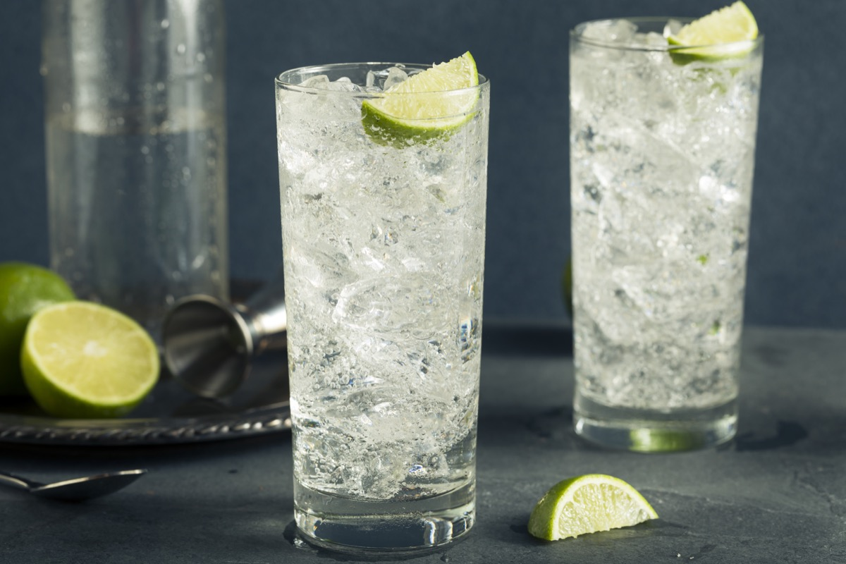 glass of vodka soda, vodka soda with lemon on a table