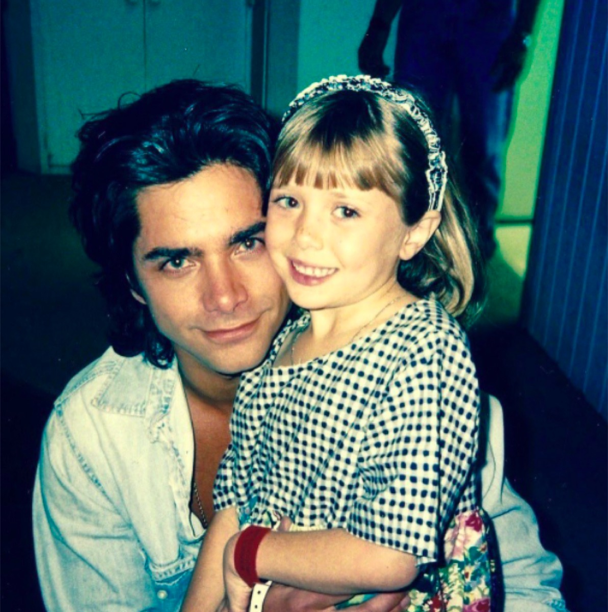 John Stamos and Elizabeth Olsen in an old photo posted to his Instagram
