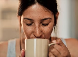 Woman drinking coffee out of a mug