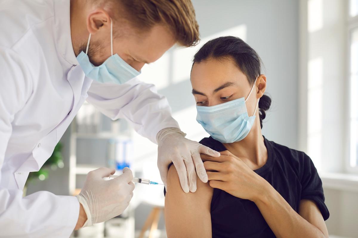 Woman getting COVID vaccine