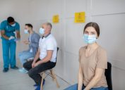 Woman waiting to get a COVID vaccine