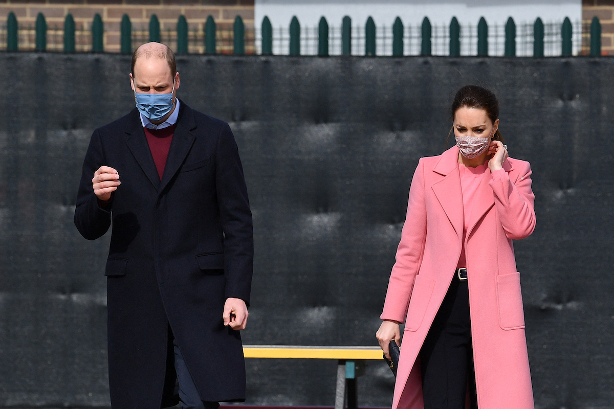 Prince William, Duke of Cambridge and Britain's Catherine, Duchess of Cambridge gesture during a visit to School21 following its re-opening after the easing of coronavirus lockdown restrictions in east London on March 11, 2021.