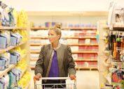 blonde woman buying pet food