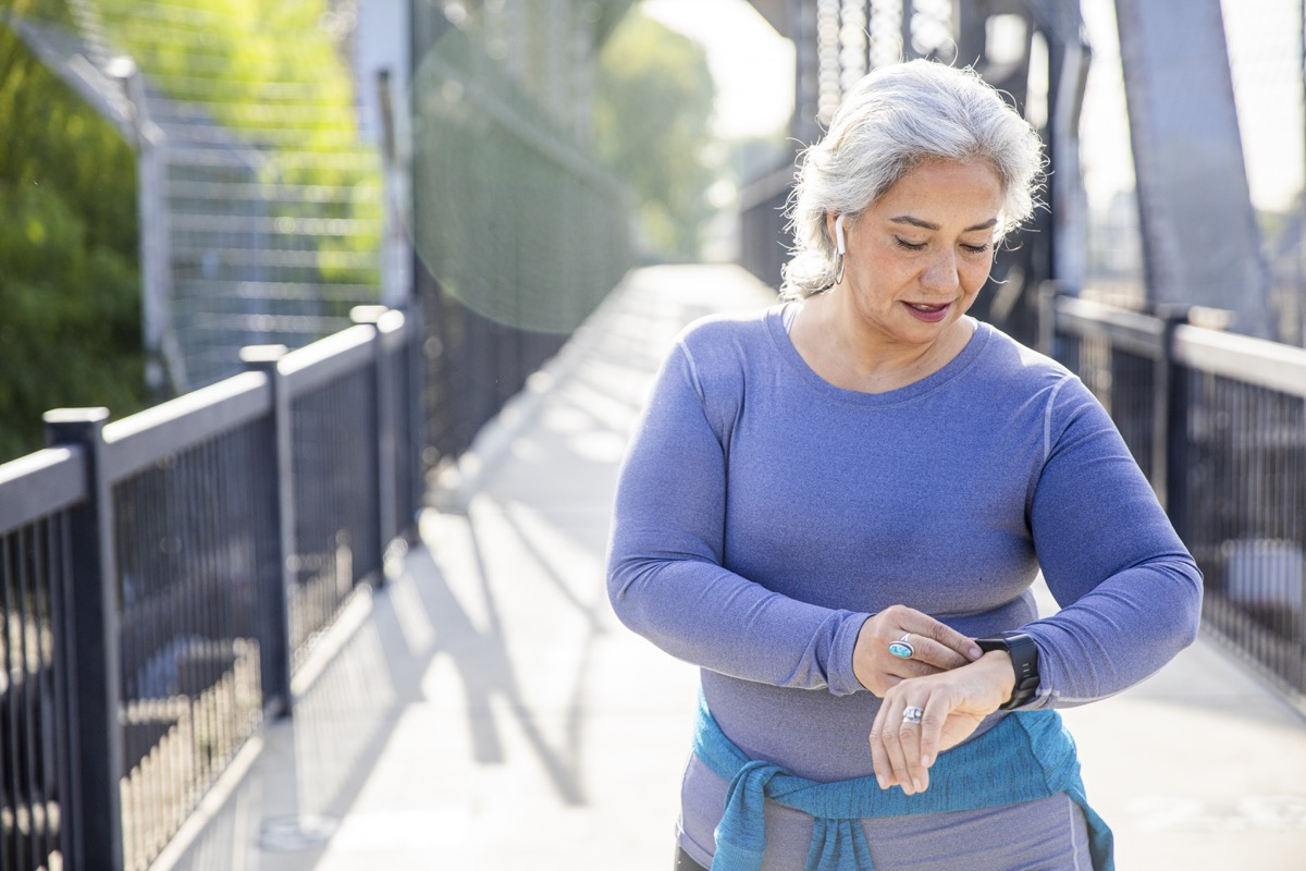 woman checking her fitness tracker