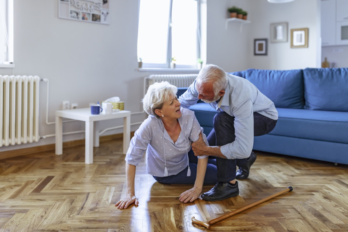 Old men helping wife who falled down on floor