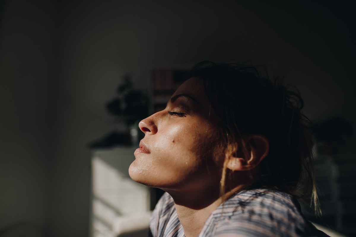 Woman getting sun from inside