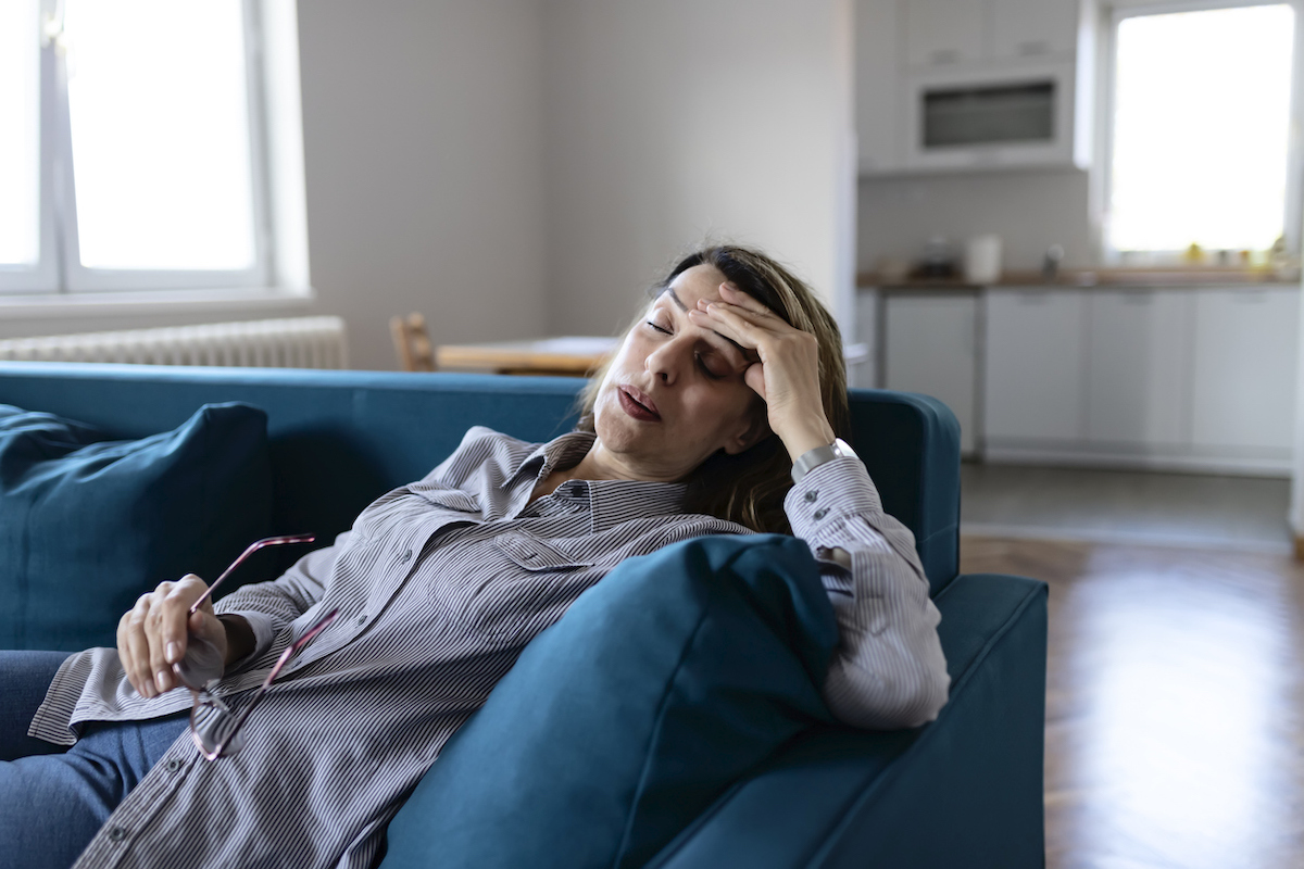 Woman at Home Suffering From Headache