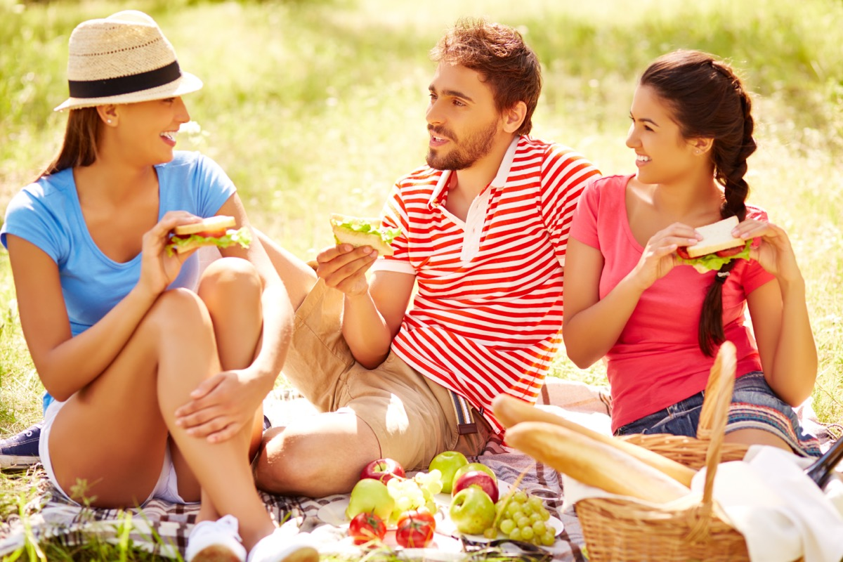 group of 20- or 30-something friends having a picnic outdoors