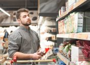 man with beard shopping in supermarket cereal aisle