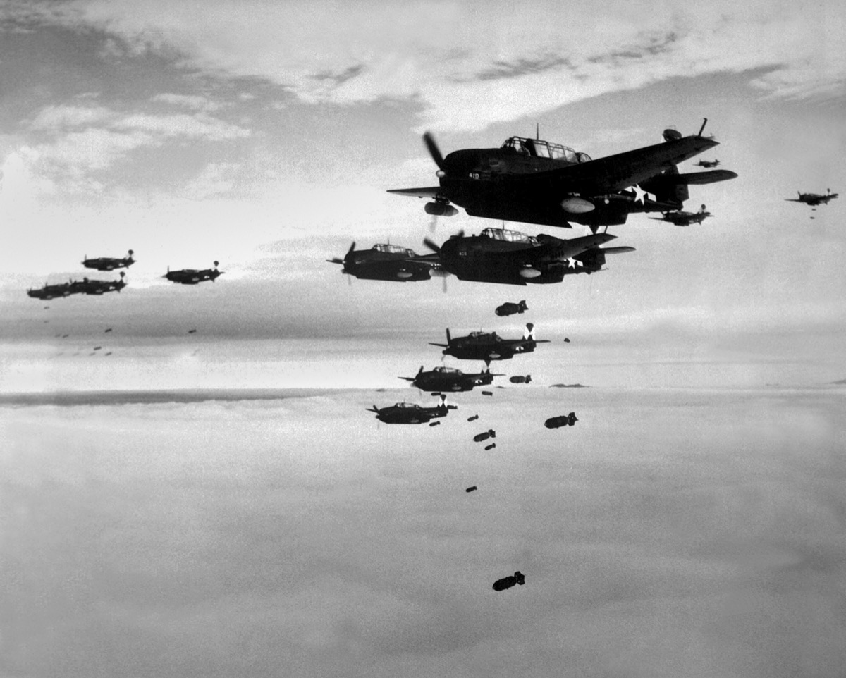 Bombs being dropped from planes in WWII