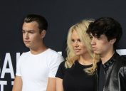 Brandon Lee, Pamela Anderson, and Dylan Lee at a Saint Laurent fashion show in Hollywood in 2016