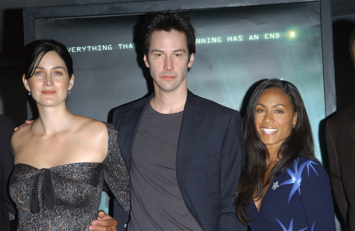 """Carrie-Anne Moss, Keanu Reeves, and Jada Pinkett Smith at a press conference for """"The Matrix Revolutions"""" in 2003"""
