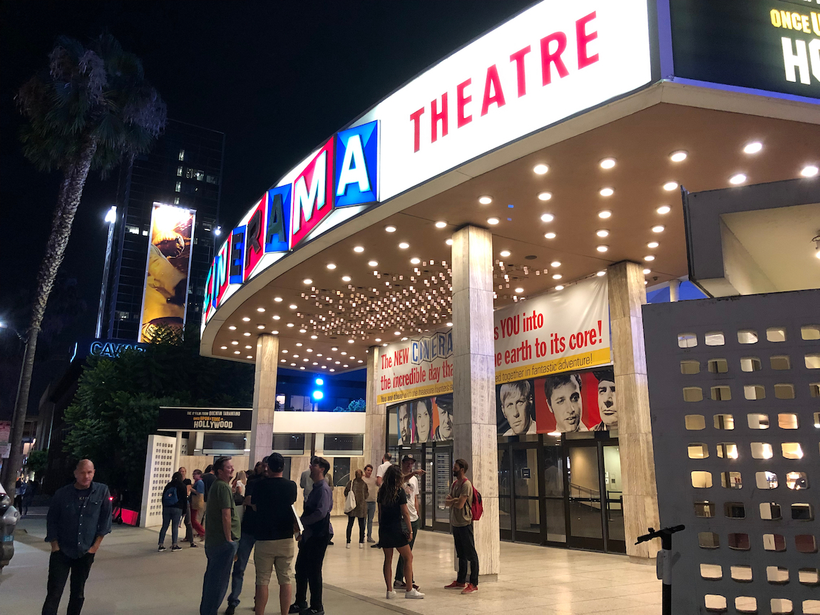 Guests standing in front of the Cinerama Dome in 2019