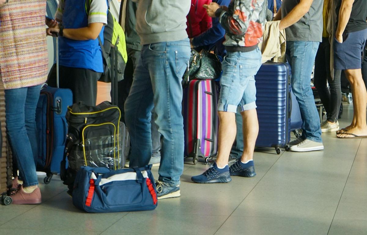 Passengers waiting at airport gate