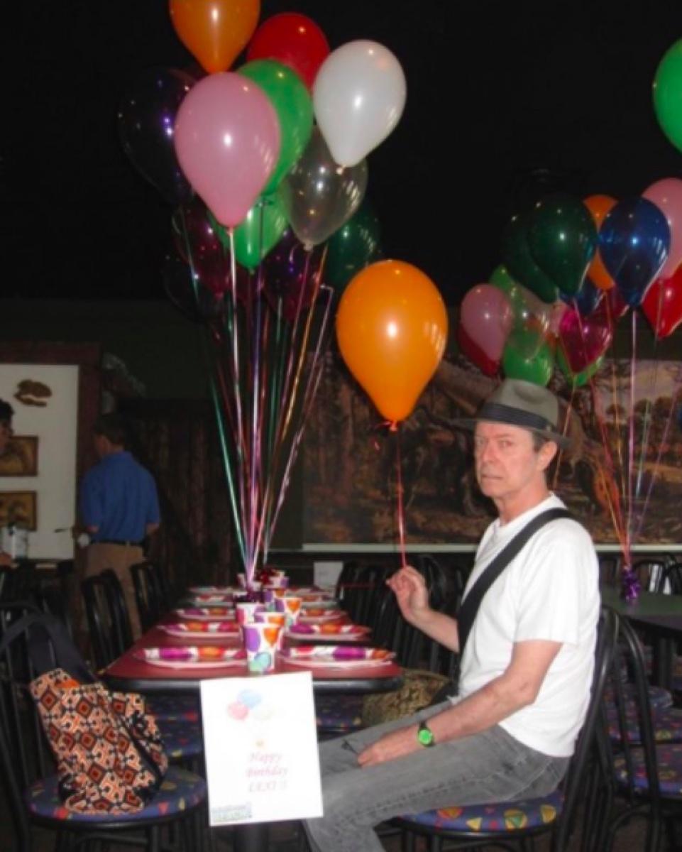 David Bowie holding a birthday balloon