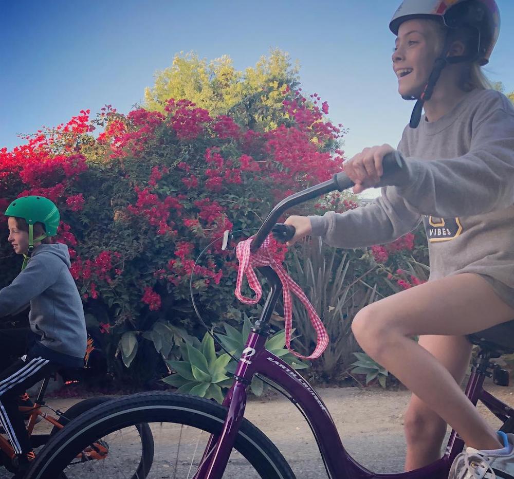 Phinnaeus and Hazel Moder riding bikes