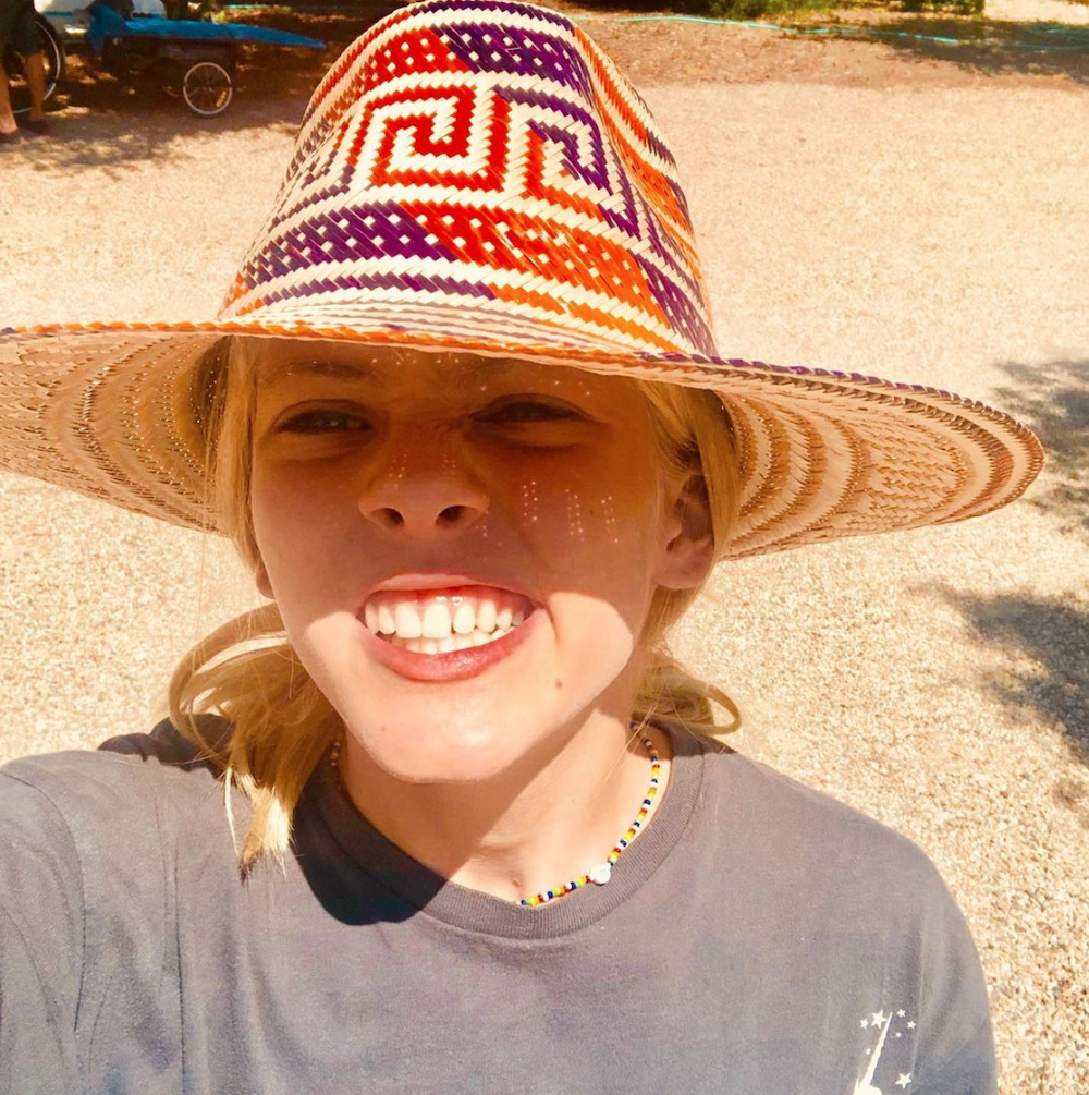 Hazel Moder posing for a selfie while wearing a large straw hat