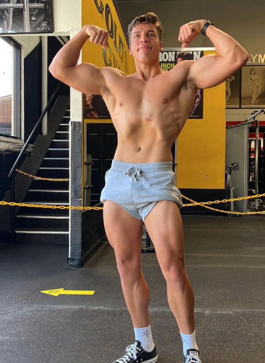 Joseph Baena striking a bodybuilding pose at the gym
