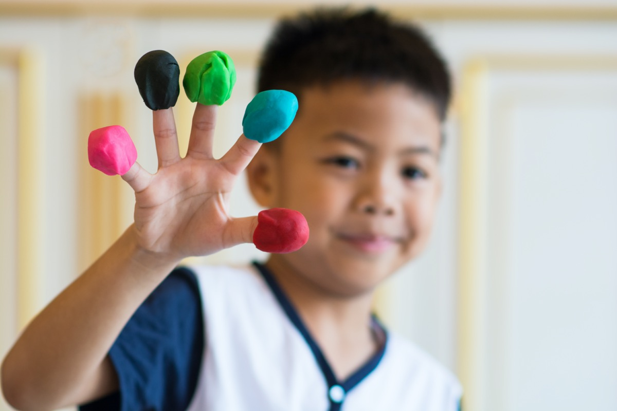 Little boy with Play-Doh on fingers