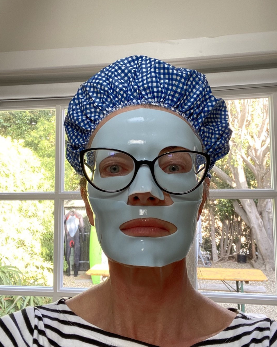 Paulina Porizkova wearing a sheet mask and shower cap in an Instagram selfie