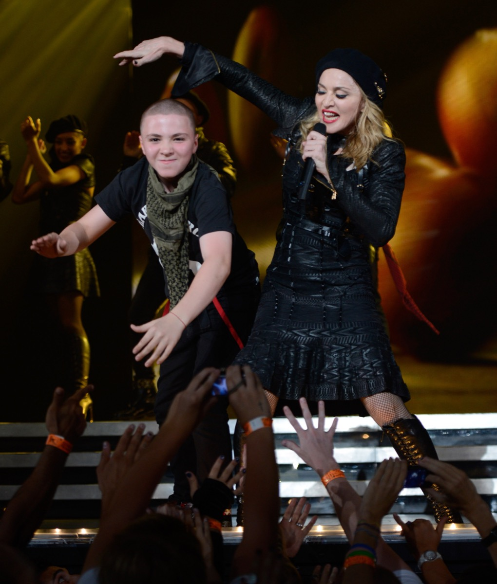 Madonna and Rocco Ritchie performing MDNA tour