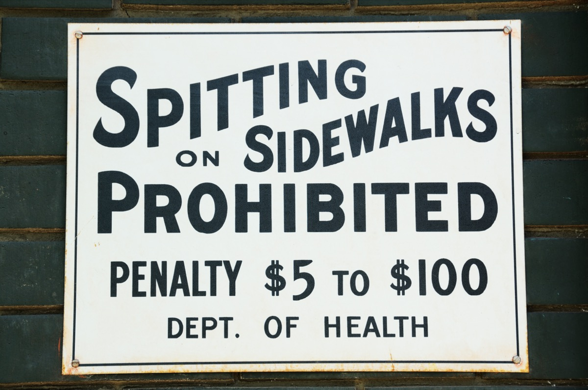"""Spitting on sidewalks prohibited"" sign"