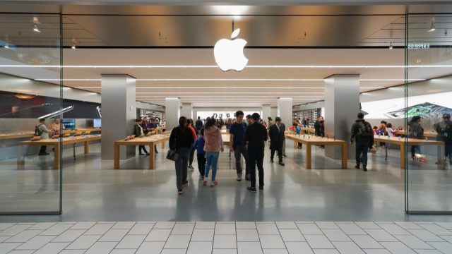 apple store exterior in mall with customers walking in