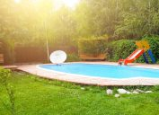 backyard with pool and red slide