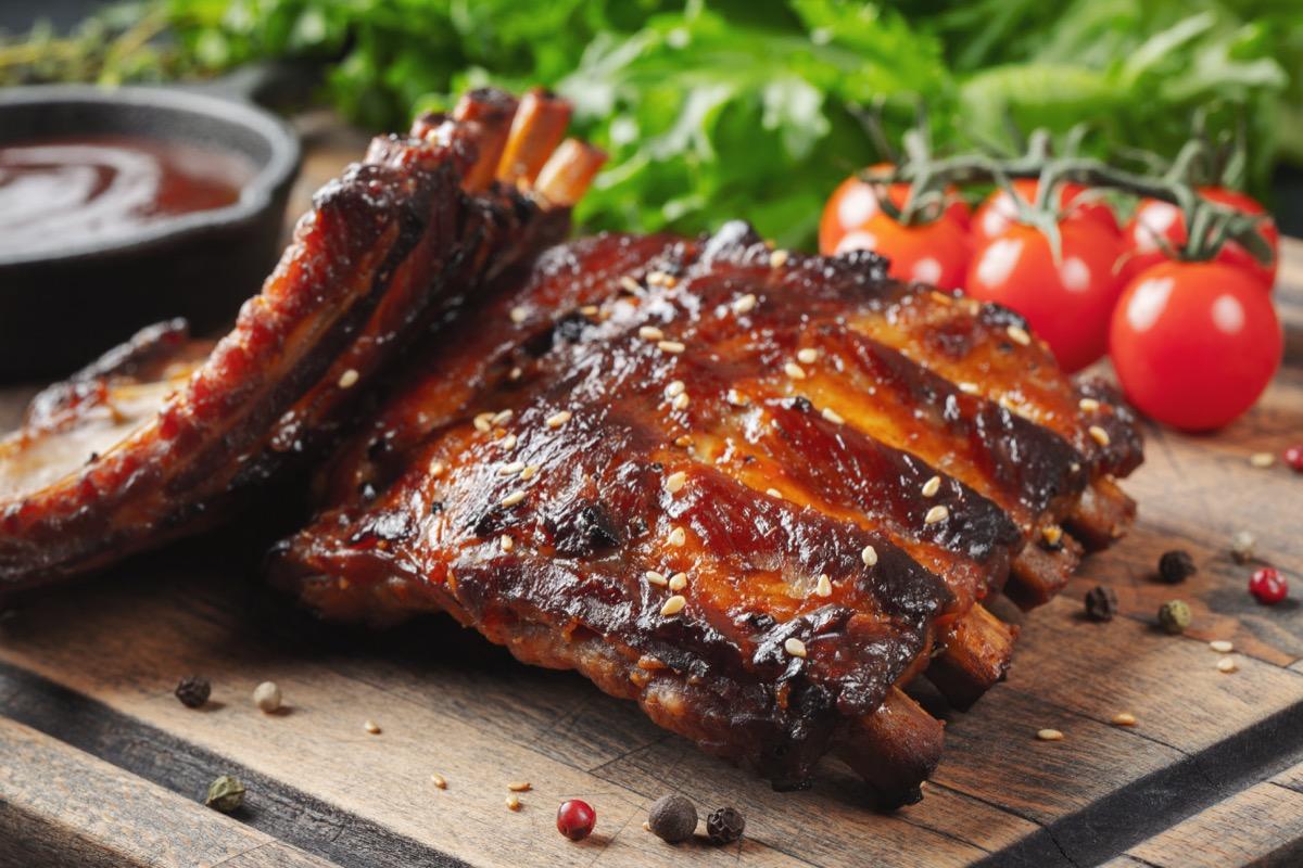 bbq ribs, tomato, sauce, wooden board
