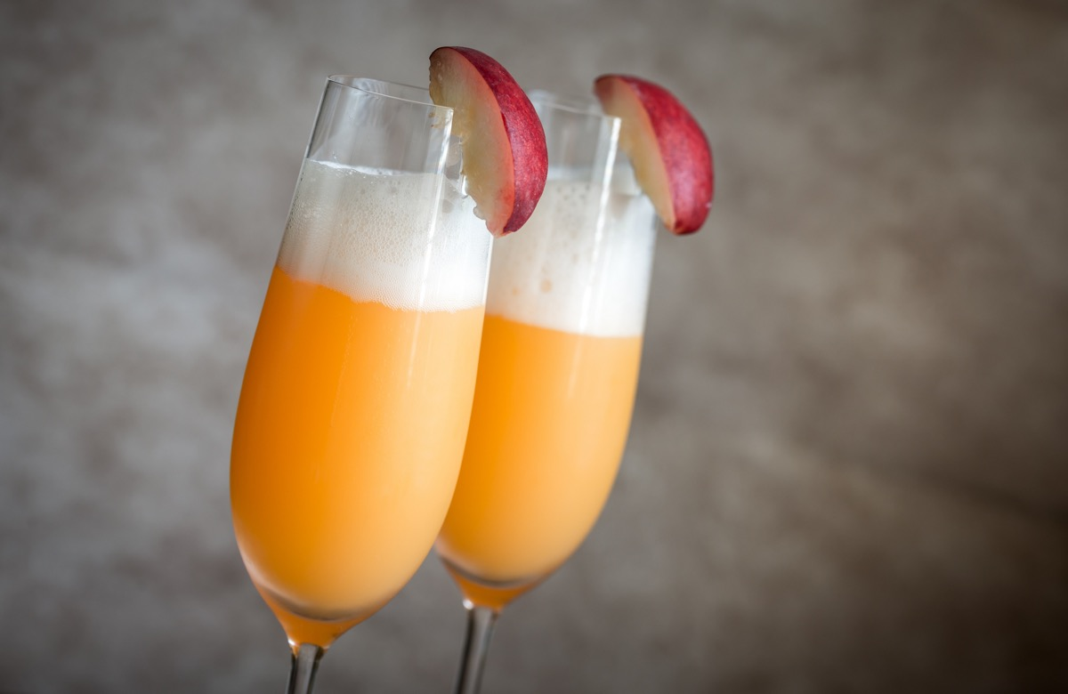 two bellini cocktails with peach