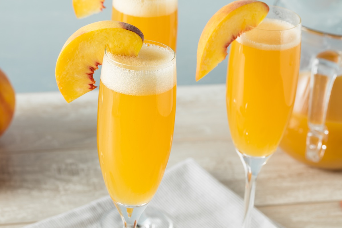 bubbly bellini cocktail with a peach