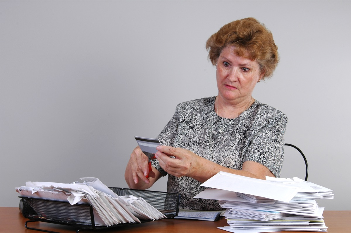 Older woman with bills